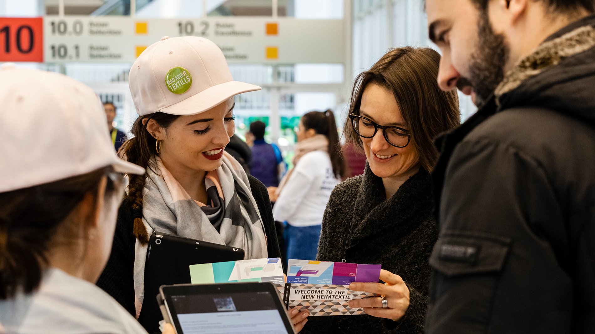 Promotion: Hostess distributes flyers at Messe Frankfurt